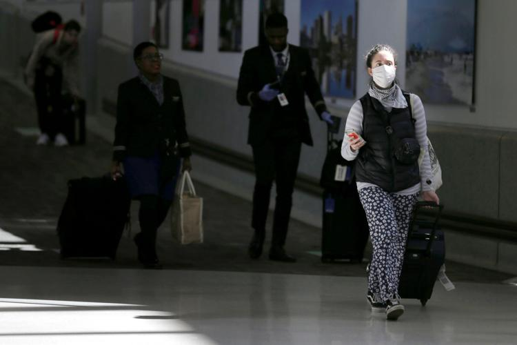 Air passengers leave a customs area March 15, 2020, at Newark Liberty International Airport in Newark, N.J..