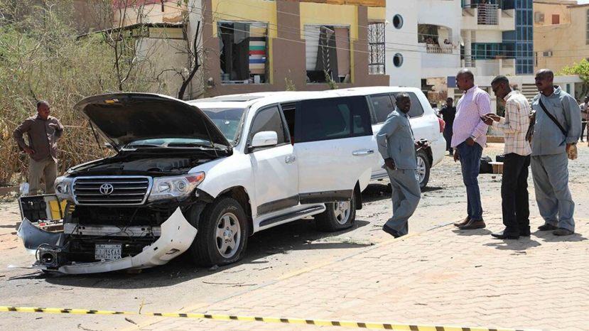 Sudanese policemen stand around vehicles that were part of Prime Mister Abdalla Hamdok's motorcade in Khartoum, Sudan, Monday,