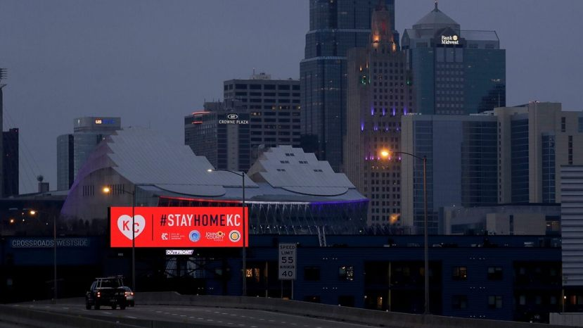 A sign downtown Kansas City, Missouri, urges residents to stay home on Tuesday,