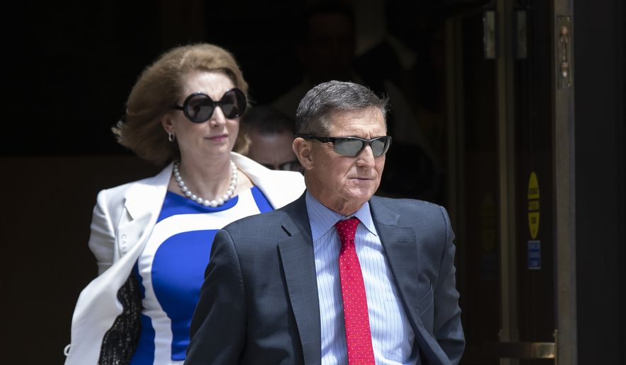 Former National Security Adviser Michael Flynn leaves the federal courthouse in Washington on Monday, June 24, 2019. Flynn's lawyer Sidney Powell is at left.