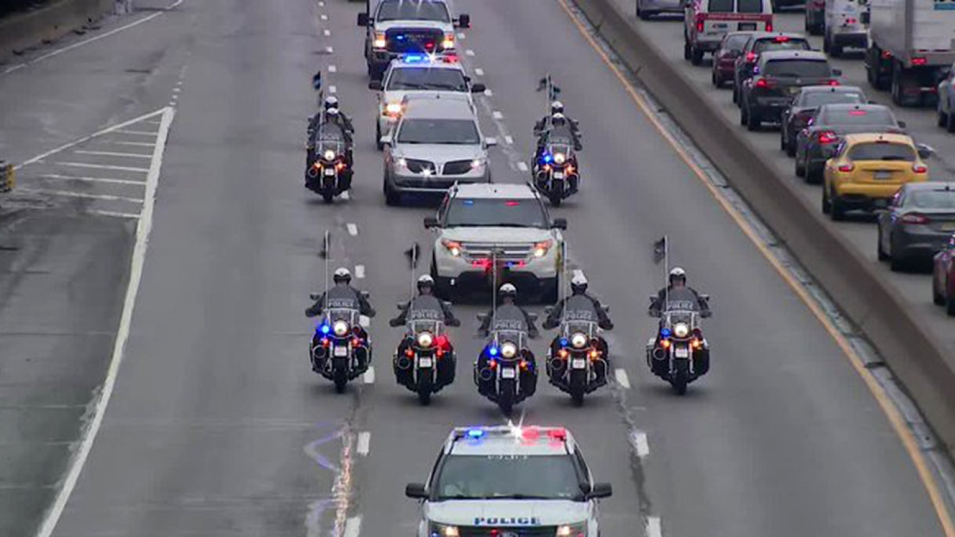 Members of the Philadelphia Police Department escorted the body of fallen officer James O'Connor from the hospital to the morgue