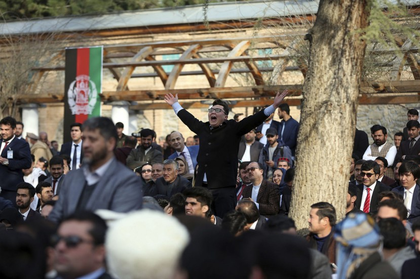 Afghan people chant after a few rockets are fired during inauguration ceremony for Afghan President Ashraf Ghani at the presidential palace in Kabul on Monday.