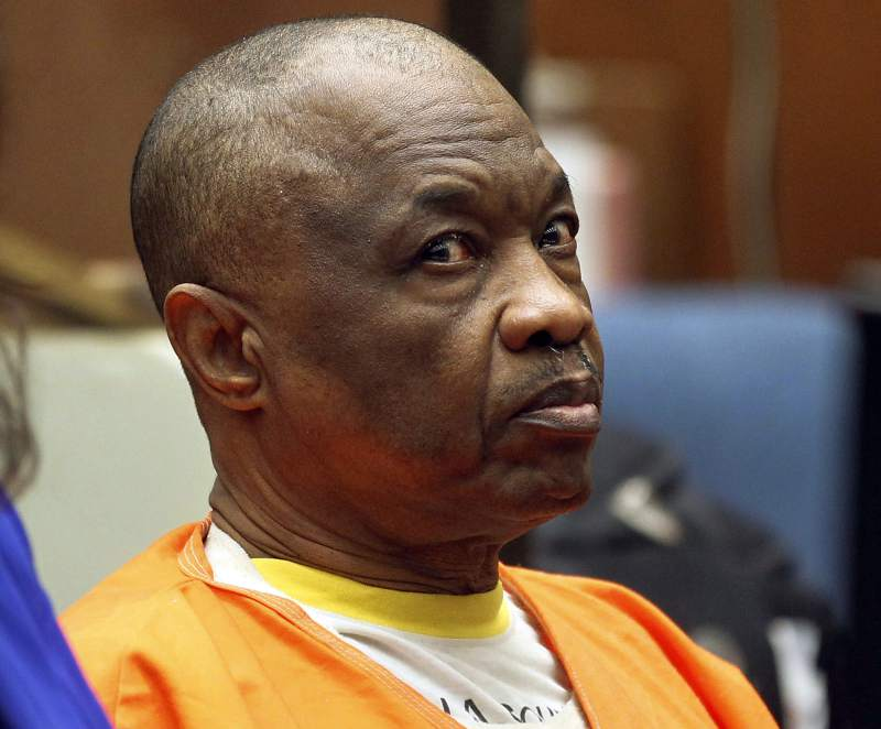 "FILE - In this Feb. 6, 2015, file photo, Lonnie Franklin Jr., who has been dubbed the ""Grim Sleeper"" serial killer, sits during a court hearing in Los Angeles."