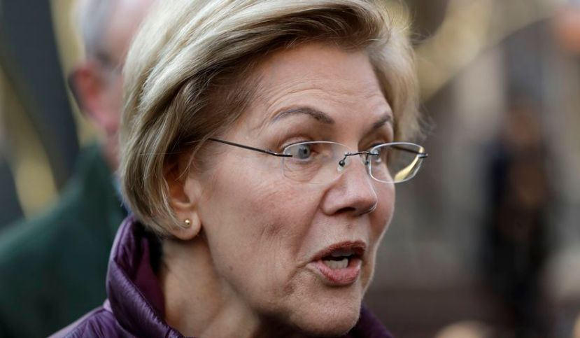 Sen. Elizabeth Warren, D-Mass., speaks to the media outside her home, Thursday, March 5, 2020, in Cambridge, Mass.,