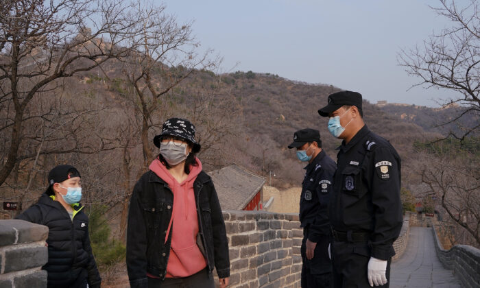 Two security guard wears a protective mask at the almost empty Badaling Great Wall on March 24, 2020 in Beijing, China.