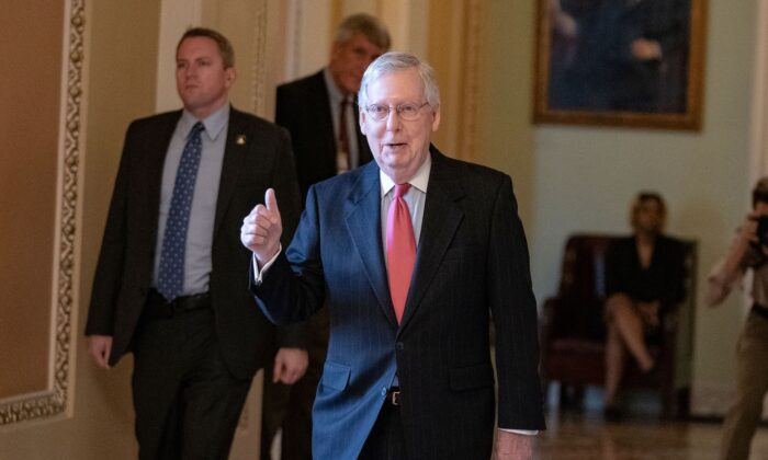 Senate Majority Leader Mitch McConnell (R-Ky.) leaves the Senate floor at the US Capitol in Washington on March 25, 2020.