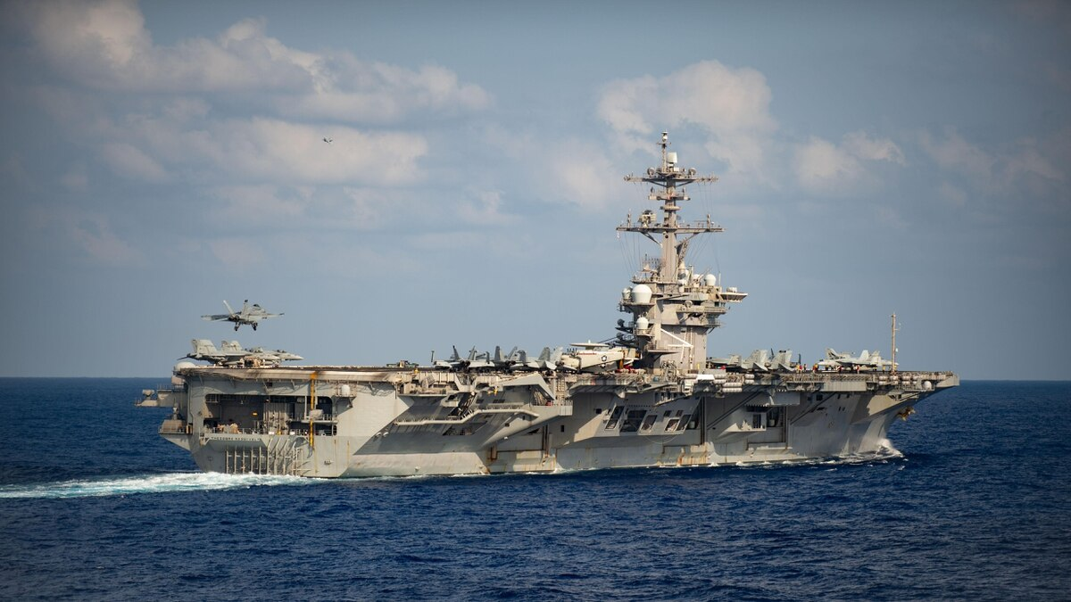 The carrier Theodore Roosevelt is pulling in to Guam to try and stop an outbreak of COVID-19 on board