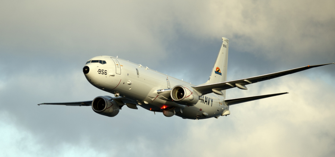 A P-8A Poseidon conducts flyovers above the Enterprise Carrier Strike Group during exercise Bold Alligator 2012.
