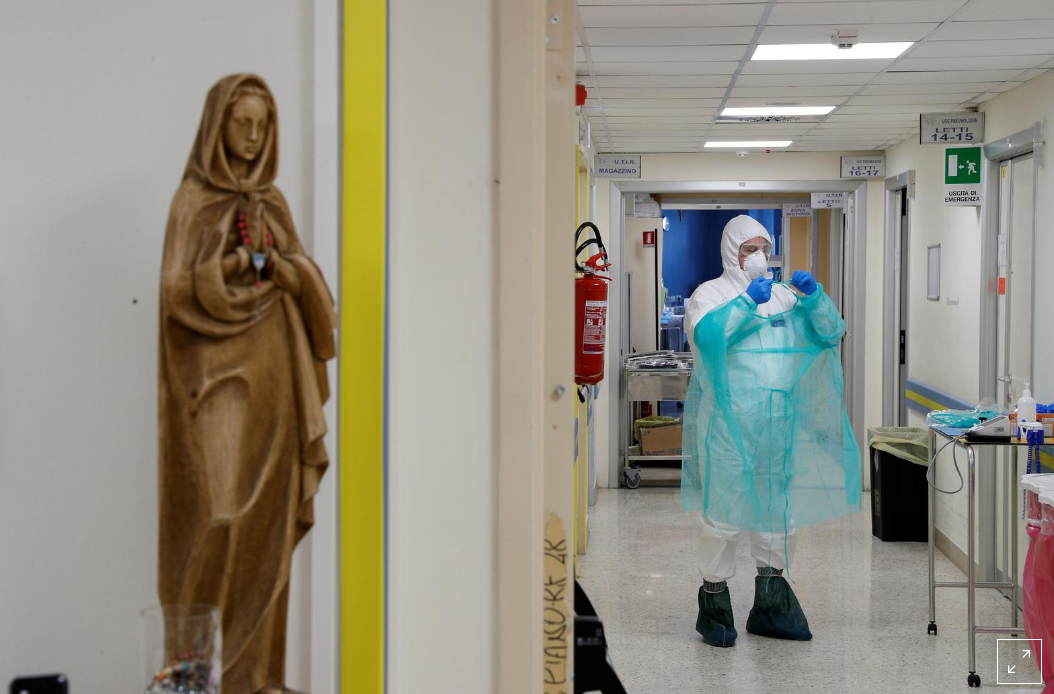 A medical worker in a protective suit is seen at the San Filippo Neri hospital, where patients suffering from the coronoavirus disease