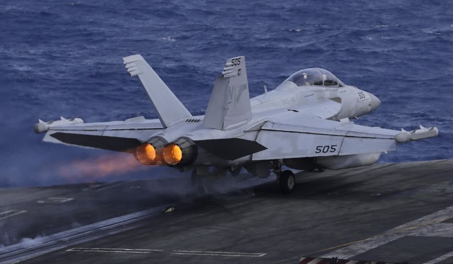 An F/A-18 Super Hornet fighter jet takes off on the deck of the U.S. Navy USS Ronald Reagan in the South China Sea, Tuesday, Nov. 20, 2018.