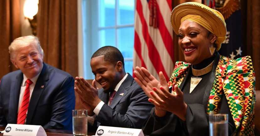President Donald Trump smiles during a meeting with Terrence Williams, center, Angela Stanton-King, right,