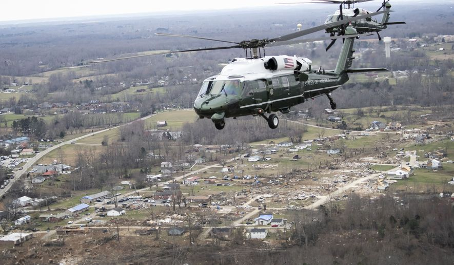 Marine One, with President Donald Trump aboard, left, flies over damage after a recent tornado, Friday, March 6, 2020,