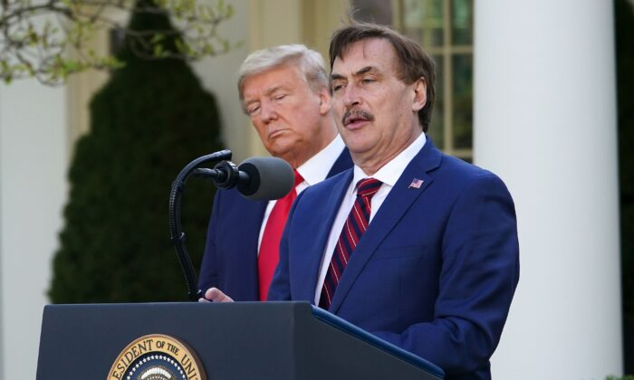 President Donald Trump listens as Michael J. Lindell, CEO of MyPillow Inc., speaks during the daily briefing on the CCP virus,