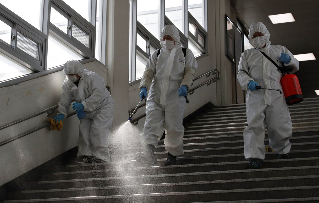 Workers disinfect a subway station in Seoul, South Korea, on Friday. (AP photo/Lee Jin-man)