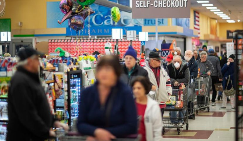 Shoppers wait in the checkout line at a Stop & Shop supermarket during hours open daily only for seniors