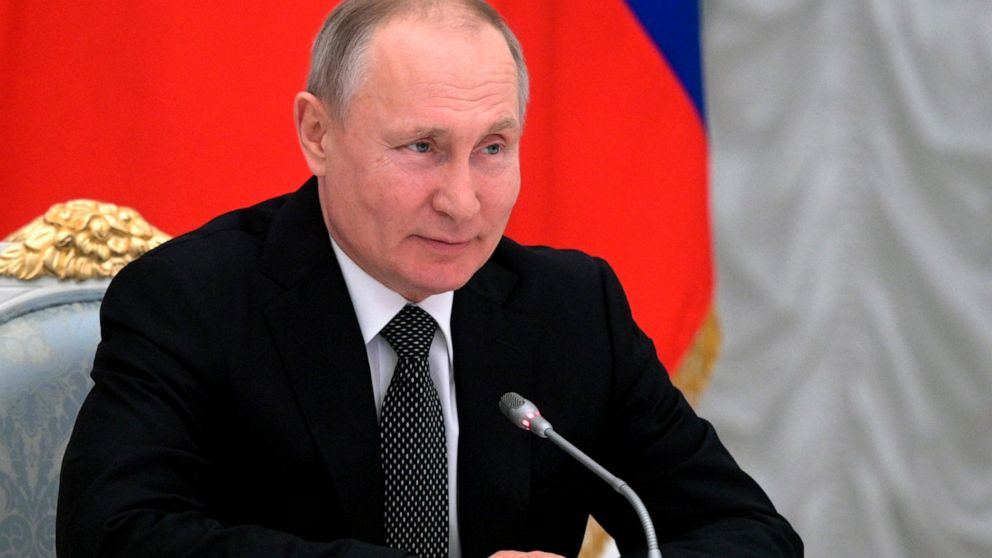Russian President Vladimir Putin speaks during a meeting with members of a working group created to discuss constitutional amendments in Moscow, Russia, Wednesday, Feb. 26, 2020. The working group proposed holding a nationwide vote on the changes on April 22.