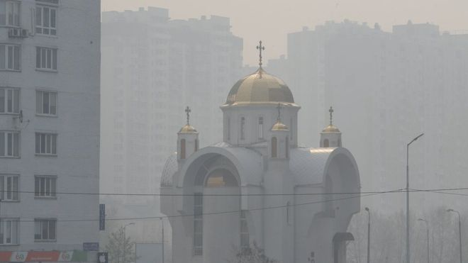 Haze from nearby wildfires shrouds buildings in Kyiv.EPA
