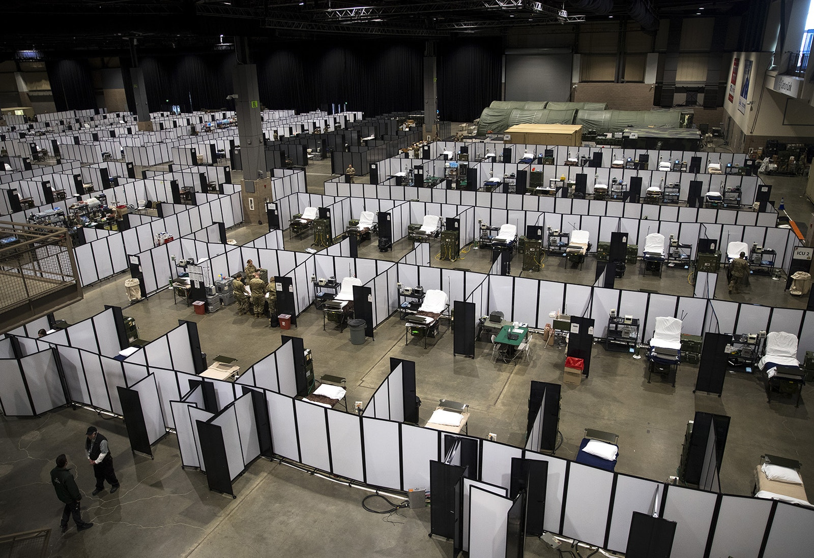 U.S. Army soldiers set up a military field hospital inside CenturyLink Field Event Center on Sunday, April 5, 2020, in Seattle.