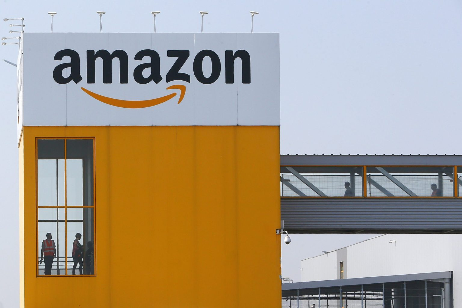 Employees observe social distancing due to coronavirus at the entrance of Amazon in Douai, France,