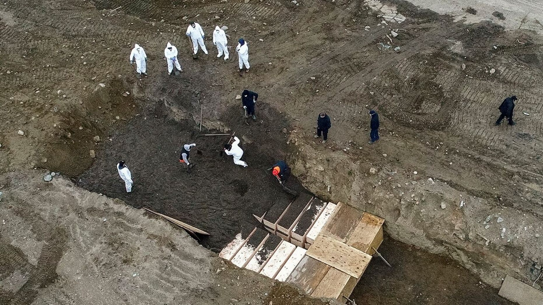 New York City's medical examiner says the city will hold onto remains for 14 days before they will be transferred to Hart Island.