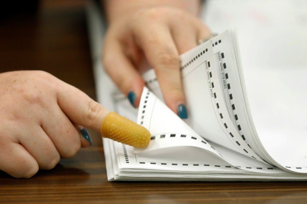 Ballots are examined and tallied | AP Photo