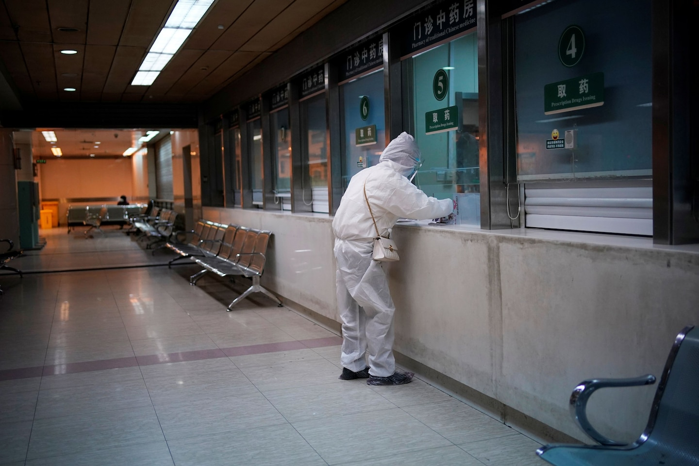A woman wearing a protective suit at a hospital in Wuhan, China.