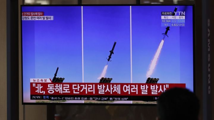 A TV screen airing reports about North Korea's firing missiles with file images of missiles at the Seoul Railway Station in Seoul, South Korea,