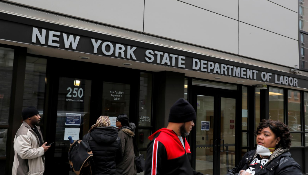 FILE PHOTO: People gather at the entrance for the New York State Department of Labor offices, which closed to the public due to the coronavirus disease (COVID-19) outbreak in the Brooklyn borough of New York City, U.S., March 20, 2020. REUTERS/Andrew Kelly