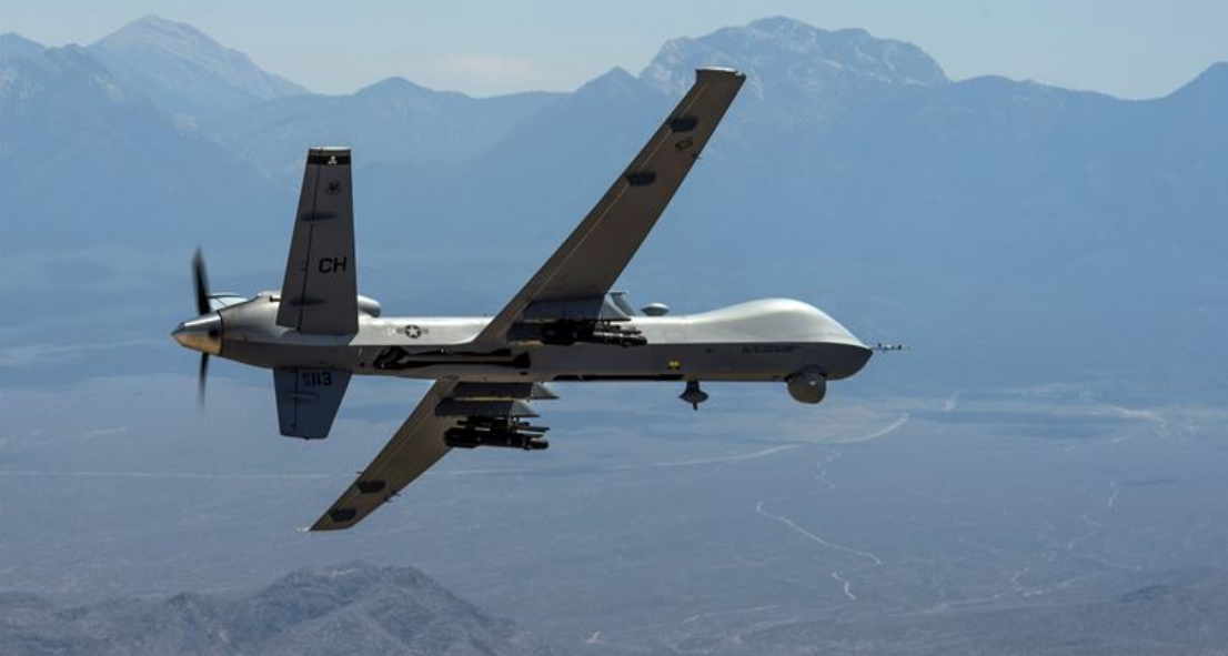An MQ-Reaper drone remotely piloted aircraft performs aerial maneuvers over