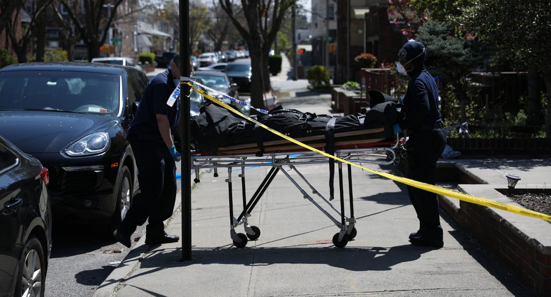 "The body of Imad ""Albert"" Ahmad, 57, is carried out by employees of the Medical Examiner Wednesday morning."