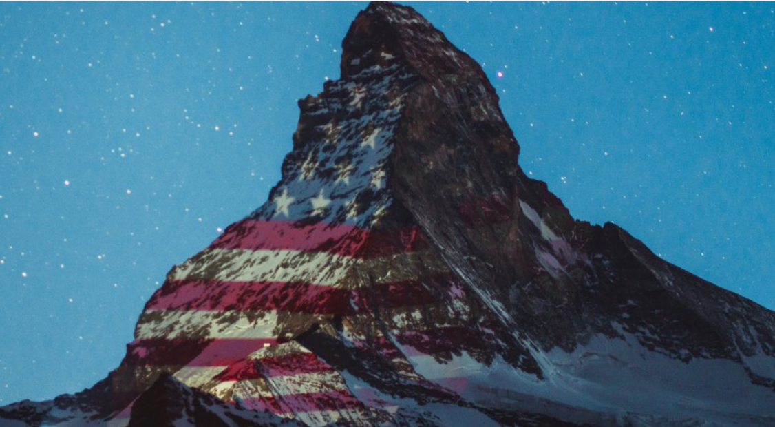 American flag image projected on the iconic Matterhorn mountain in the Swiss Alps.
