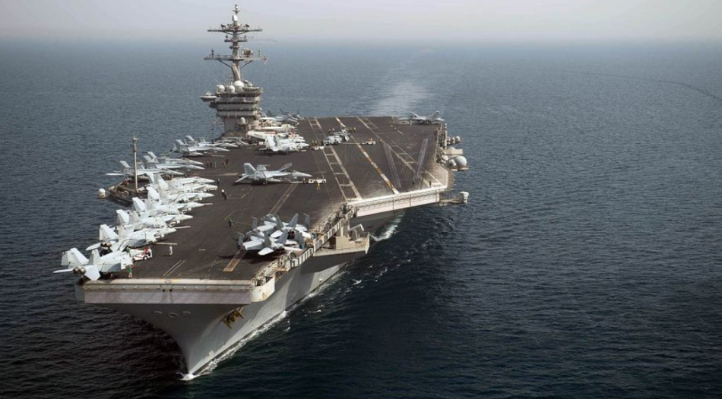 The aircraft carrier USS Theodore Roosevelt transits the Arabian Gulf. (Anthony Rivera/U.S. Navy)