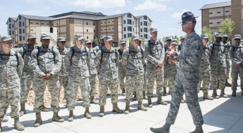Tech. Sgt. Paul Couch, 323rd Training Squadron military training instructor, provides a tour to chaplain candidates of an Airman Training Complex at Joint Base San Antonio-Lackland, Texas, July 5, 2017.