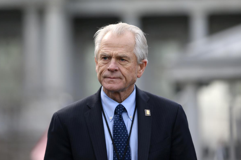 FILE PHOTO: White House trade adviser Peter Navarro listens to a news conference about a presidential executive order