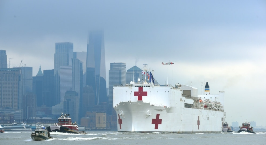 Coast Guard assets, along with New York Police Department and New York Fire Department assets, provide a security escort for the USNS Comfort arrival into New York Harbor, March 30, 2020.