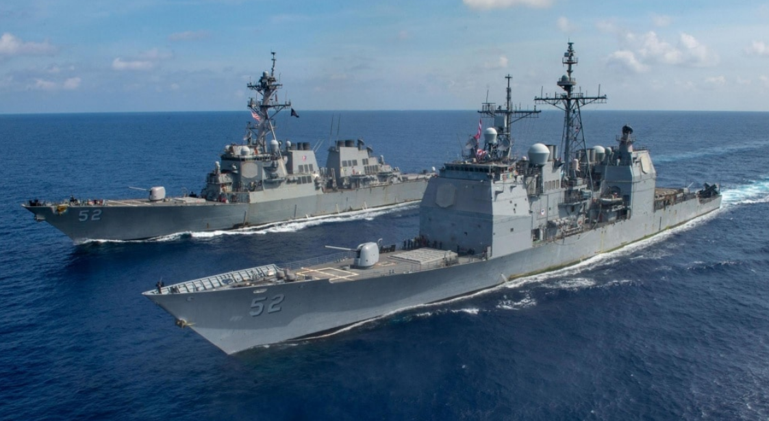 The U.S. Navy Ticonderoga-class guided missile cruiser USS Bunker Hill (CG 52), front, and Arleigh-Burke class guided missile destroyer USS Barry (DDG 52) transit the South China Sea.