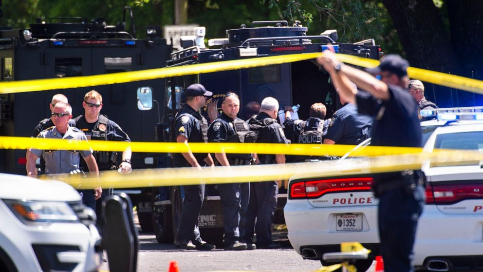 Baton Rouge Police Department officers gather at the site of a shooting in Baton Rouge, La., Sunday, April 26, 2020. The shooting has left one police officer dead and a wounded colleague fighting for life,