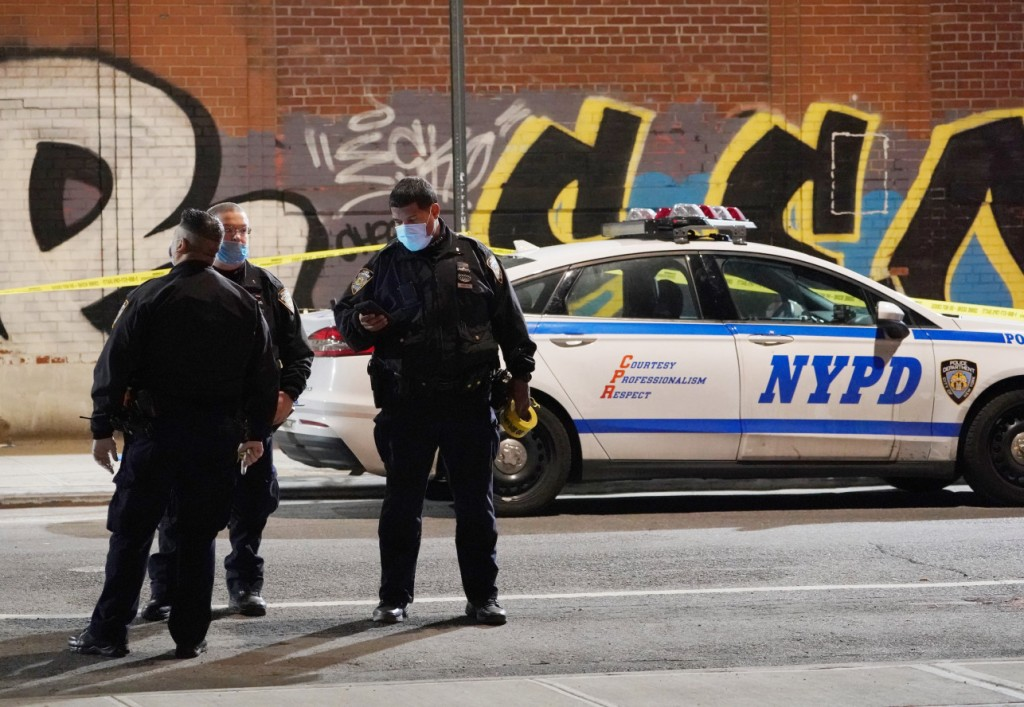 Police at the scene where a person was stabbed on New York City's Lower East Side. Christopher Sadowski