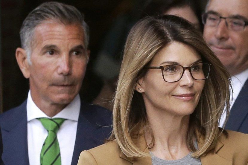 FILE - In this April 3, 2019, file photo, actress Lori Loughlin, front, and her husband, clothing designer Mossimo Giannulli, left,