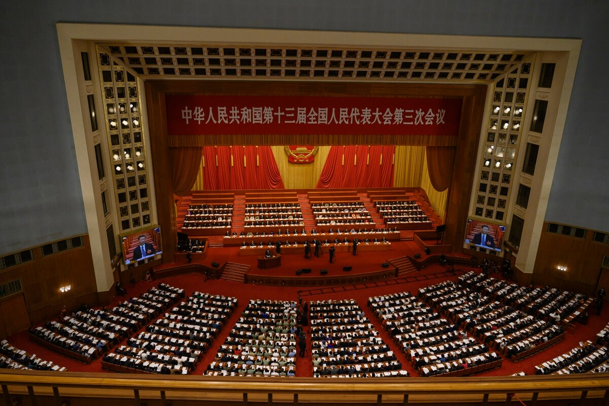 China's Communist Party leaders and delegates, including President Xi Jinping, sit at the opening of the National People's Congress on May 22, 2020,