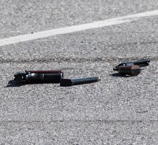 Guns could be seen on the ground in the parking lot outside the Walmart in Manchester following a reported shooting Sunday afternoon.
