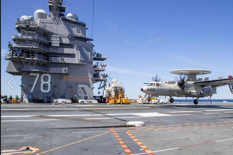 An E2-D Advanced Hawkeye aircraft touches down on the aircraft carrier USS Gerald R. Ford.