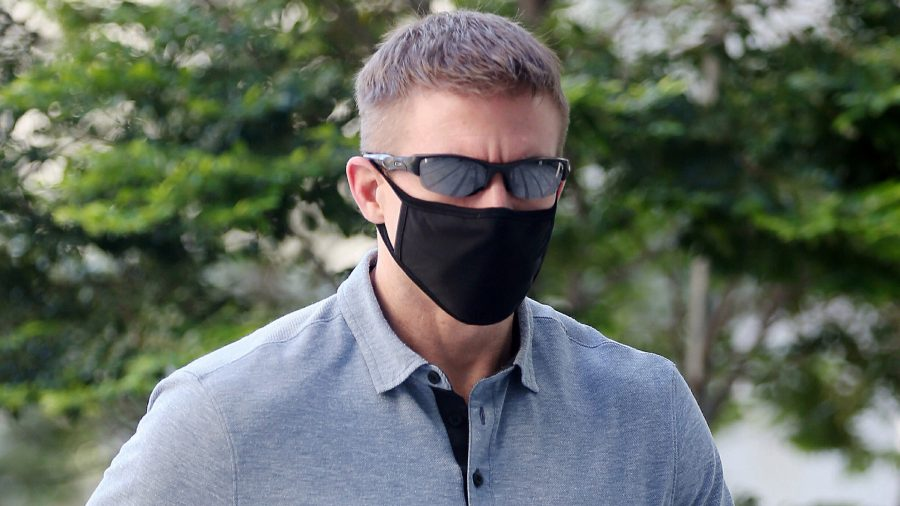 Brian Dugan Yeargan, wearing a face mask and sunglasses, walks outside the Singapore State Court in Singapore, on May 13, 2020.