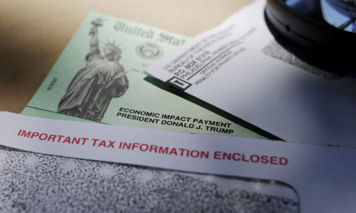 President Donald Trump's name is seen on a stimulus check issued by the IRS ,