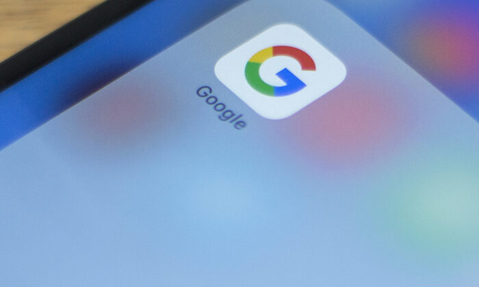 Google's logo on a phone in this photo illustration on July 10, 2019. (Alastaire Pike/AFP via Getty Images)