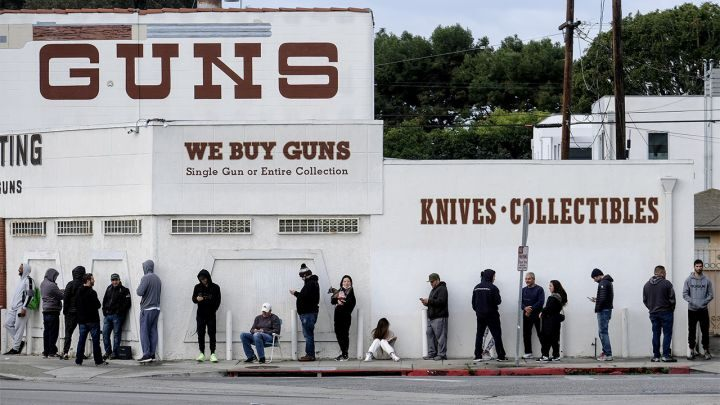 People wait in line to enter a gun store in Culver City, Calif., March 15, 2020.