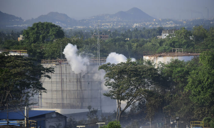 Smoke rises from LG Polymers plant, the site of a chemical gas leakage, in Vishakhapatnam, India, on May 7, 2020.