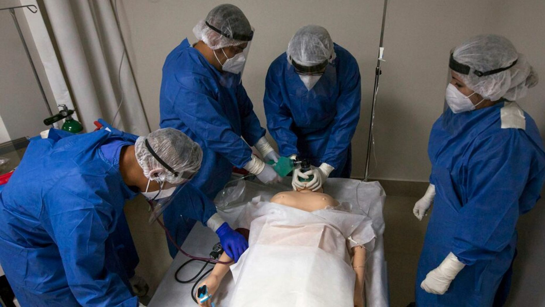 Military doctors and nurses train with a mannequin on the premises of a hospital to receive patients with Covid-19 in Monterrey, Nuevo Leon, Mexico, on May 18, 2020.