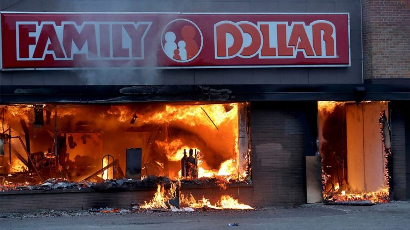 Fire burns inside The Family Dollar Store after a night of unrest and protests in the death of George Floyd early Friday, May 29, 2020 ,