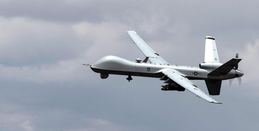 An MQ-9 Reaper remotely piloted aircraft performs aerial maneuvers over Creech Air Force Base, NV., June 25, 2015.